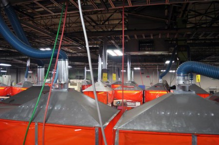Robotic weld cells are equipped with individual hoods